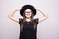 Young Girl Doing Emotion. Dressed In A Black Shirt, Black Hat, Glasses. Royalty Free Stock Images - 87874969