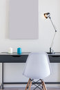 Small Office Desk With White Chair And Single Lamp Stock Image - 87883411
