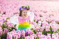 Little Girl In Fairy Costume Playing In Flower Field Stock Images - 87889554