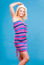Blonde Woman Wearing Short Colorful Striped Dress Stock Photo - 87902260