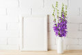 White Frame Mockup With Purple Campanula Bouquet Near Brick Wall Royalty Free Stock Photography - 87902917