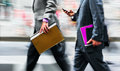 Motion Blurred Business People Walking On The Street Royalty Free Stock Photo - 87943945