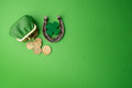 St. Patricks Day, Lucky Charms. Horesechoe And Shamrock On Green Background Stock Images - 87962734
