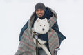 Young Sri Lankan Man Embracing Solid White Fluffy Dog In Winter. Selective Focus In Dog Stock Photos - 87966813
