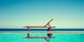 Reclining Chair Near A Swimming Pool, Sea And Blue Sky Stock Images - 87974034