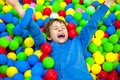 Happy Little Kid Boy Playing At Colorful Plastic Balls Playground High View. Funny Child Having Fun Indoors. Royalty Free Stock Photography - 88005357