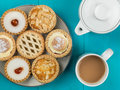 Plate Of Assorted Individual Cakes Or Tarts With A Pot Of Tea Stock Photo - 88050320