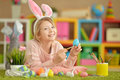 Cute Girl Paint Easter Eggs Royalty Free Stock Images - 88058229