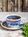 Herbal Tea With Mint In A Blue Cup Royalty Free Stock Photography - 88092387