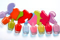 Photo Of Spilled From Many Bottles Colorful Nail Polish On White Background. Stock Photo - 88095970