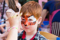Child Boy Face Painting, Making Tiger Eyes Process Stock Photo - 88096800