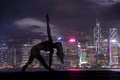 Double Exposure Of Silhouette Yoga Woman Against Hong Kong City Stock Photos - 88178243