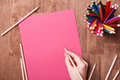 Girl Hand Drawing, Blank Pink Paper And Colorful Pencils On Wooden Table Stock Photo - 88221200
