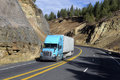 SEMI TRUCK DRIVING ON MOUNTAIN HIGHWAY Royalty Free Stock Photos - 88245568