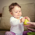Cute Baby Girl Plays With Fruit At Home Stock Photos - 88282373