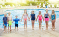 Group Of Children Playing Together At The Swimming Pool Stock Photos - 88314093