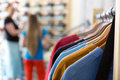Row Of Summer Seasonal Apparel And Customers In Retail Shop Stock Photo - 88320090