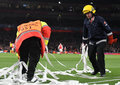 Workers Cleaning Confetti Off The Pitch Royalty Free Stock Images - 88351359
