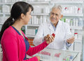Senior Chemist And Woman With Prescription In Pharmacy Royalty Free Stock Images - 88359909