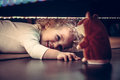 Funny Cute Smiling Baby Playing Hide And Seek Under The Bed With Toy Hamster In Vintage Style Royalty Free Stock Photo - 88365425