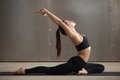 Young Woman In One Legged King Pigeon Pose, Grey Studio Stock Images - 88390794