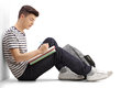 Teen Student Writing In A Notebook Stock Photos - 88418763