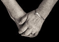 Pensioner`s Hands With Medical Alert Bracelet For Diabetes. Mono Royalty Free Stock Photography - 88435327