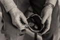 Elderly Lady`s Hands Checking Money In Her Purse. Royalty Free Stock Photography - 88437997