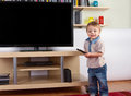 Happy Toddler With Remote Control In Front Of The TV Royalty Free Stock Photo - 88456515