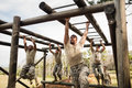 Soldiers Climbing Monkey Bars Royalty Free Stock Photography - 88463727