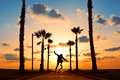 Man Jumping On Skateboard In Sunset Royalty Free Stock Photo - 88528695