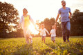Mother And Father With Children Running In Nature Royalty Free Stock Photography - 88529187