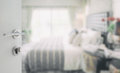 Opened White Door To Blurred Background Of Modern Bedroom Stock Photos - 88546083