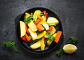 Roasted Vegetables In Black Iron Plate Stock Images - 88549954