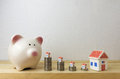 Piggy Bank With House And Coins Royalty Free Stock Photos - 88562188