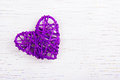 Purple Wicker Heart On A White Wooden Background. Eco Valentine. Heart Of Vines. Stock Photo - 88590360