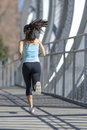 Young Beautiful Athletic Sport Woman Running And Jogging Crossing Modern Metal City Bridge Royalty Free Stock Photography - 88604117