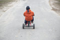 The Little Boy Is Riding A Tricycle Stock Photography - 88613962