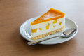 A Piece Of Mango Cheese Cake On Wooden Background Royalty Free Stock Images - 88637219