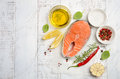 Fresh Raw Salmon Steak With Lemon, Olive Oil And Spices On Rustic Wooden Background. Ingredients For Making Healthy Dinner. Health Stock Photo - 88645400