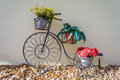 Bicycle With Flower Pots And Rocks Royalty Free Stock Photo - 88661605
