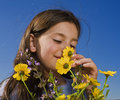 Young Girl Smelling Flowers Royalty Free Stock Images - 8874619