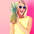 Happy Young Woman Holding A Pineapple Royalty Free Stock Photo - 88717435