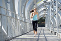 Young Beautiful Athletic Sport Woman Running And Jogging Crossing Modern Metal City Bridge Stock Image - 88738111