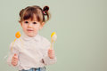 Indoor Portrait Of Cute Happy Baby Girl Playing With Easter Decorations Stock Image - 88747001