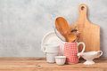 Kitchen Utensils And Tableware On Wooden Table Over Rustic Background Royalty Free Stock Photo - 88748985