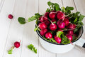 Red Radishes In Bowl On Wooden Table Royalty Free Stock Images - 88754989