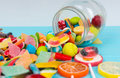 Cattered Tasty Candies And Lollipops As Fruits Near Fallen Glass Royalty Free Stock Photos - 88847398