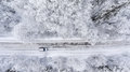 One Vehicle Driving Through The Winter Snowy Forest On Country Road. Top View Royalty Free Stock Photo - 88853435