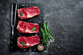 Raw Meat, Beef Steak On Black Background Stock Photography - 88853942
